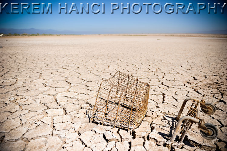 shopping cart on a barren desert floor